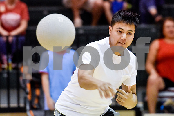 Jonathan Moya throws a ball during the third annual dodgeball challenge at John Alexander Gym in Jacksonville, Texas, on Monday, June 5, 2017. The dodgeball game kicked off a week of events for the Jacksonville Tomato Festival. (Chelsea Purgahn/Tyler Morning Telegraph)