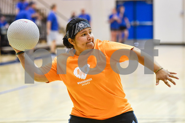 Alex Barrientos prepares to throw a ball during the third annual dodgeball challenge at John Alexander Gym in Jacksonville, Texas, on Monday, June 5, 2017. The dodgeball game kicked off a week of events for the Jacksonville Tomato Festival. (Chelsea Purgahn/Tyler Morning Telegraph)