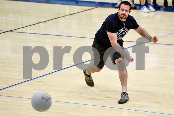 A man throws a ball during the third annual dodgeball challenge at John Alexander Gym in Jacksonville, Texas, on Monday, June 5, 2017. The dodgeball game kicked off a week of events for the Jacksonville Tomato Festival. (Chelsea Purgahn/Tyler Morning Telegraph)