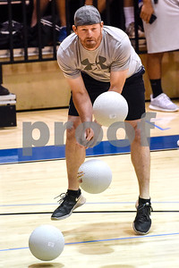Anthony Brumit attempts to catch balls during the third annual dodgeball challenge at John Alexander Gym in Jacksonville, Texas, on Monday, June 5, 2017. The dodgeball game kicked off a week of events for the Jacksonville Tomato Festival. (Chelsea Purgahn/Tyler Morning Telegraph)