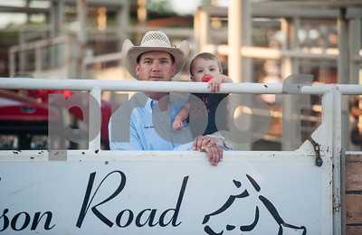 Kyle Jones of Gladewater holds his son Cooper Jones, 1,before the start of the XTreme Bulls night at the Gladewater Round-Up Rodeo Wednesday June 7, 2017.  (Sarah A. Miller/Tyler Morning Telegraph)