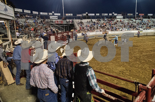 Men in cowboy hats watch a junior bull rider ride a bull during XTreme Bulls night at the Gladewater Round-Up Rodeo Wednesday June 7, 2017.  (Sarah A. Miller/Tyler Morning Telegraph)