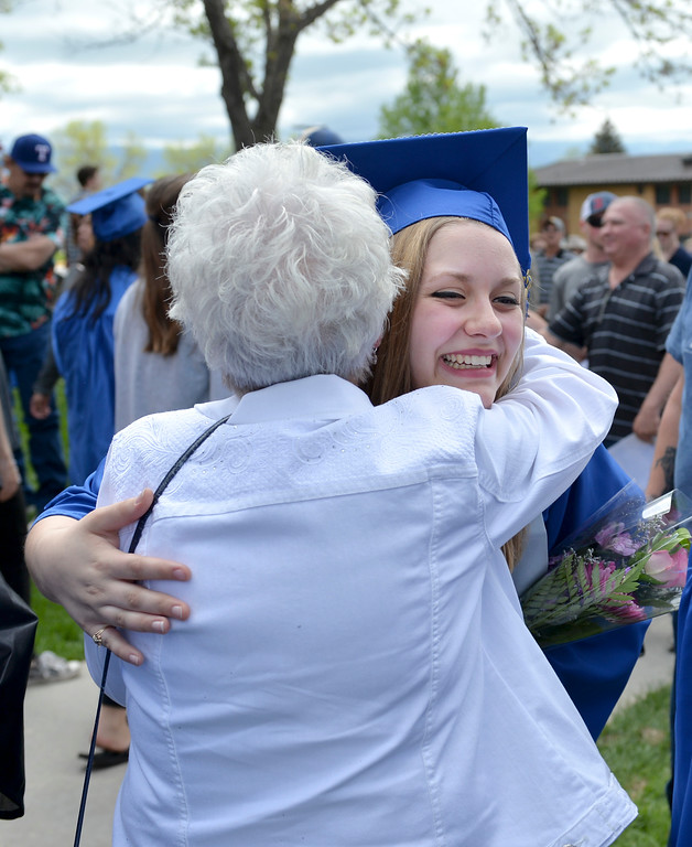 Justin Sheely | The Sheridan Press<br /> Kate Olson is congratulated by family after graduating with her Associates in Culinary Science and Hospitality during the 68th Commencement Ceremony Saturday in the Bruce Hoffman Golden Dome at Sheridan College.