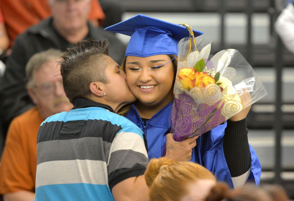 Justin Sheely | The Sheridan Press<br /> Stacy Bargar congratulates Andrea Torres after she received her Certificate of High School Equivalency during the 68th Commencement Ceremony Saturday in the Bruce Hoffman Golden Dome at Sheridan College.