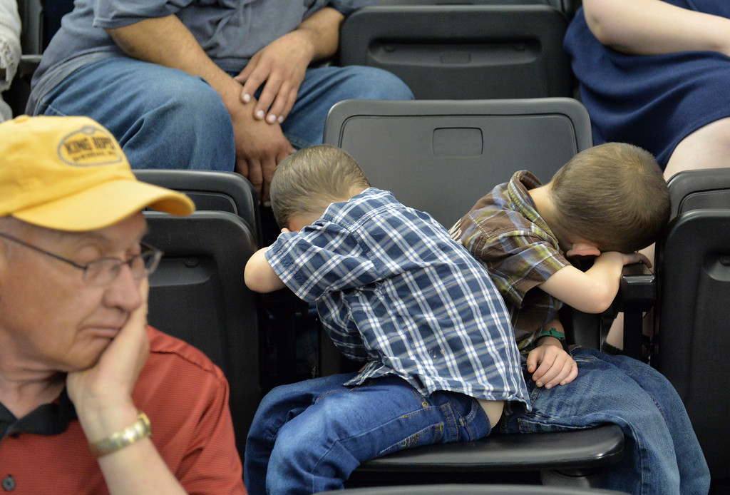 Justin Sheely | The Sheridan Press<br /> Some children fall asleep during the 68th Commencement Ceremony Saturday in the Bruce Hoffman Golden Dome at Sheridan College.