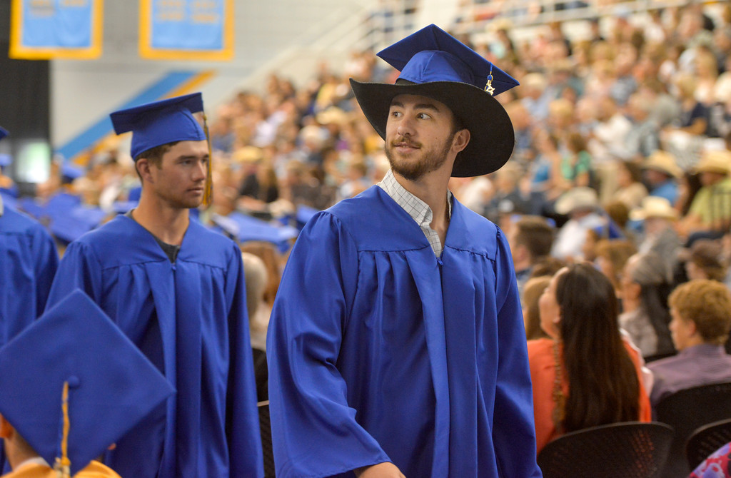Justin Sheely | The Sheridan Press<br /> Graduate Ty Fauber walks towards the stage during the 68th Commencement Ceremony Saturday in the Bruce Hoffman Golden Dome at Sheridan College.