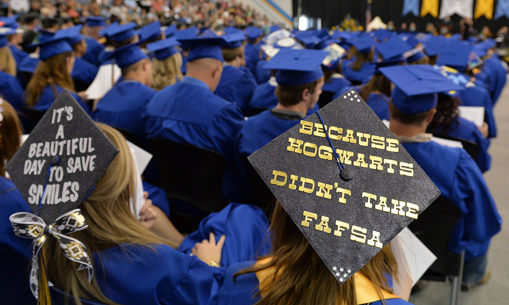 Justin Sheely | The Sheridan Press<br /> Some graduates wore decorated mortar boards during the 68th Commencement Ceremony Saturday in the Bruce Hoffman Golden Dome at Sheridan College.