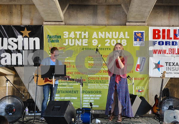 Reagan Johnson performs at the 34th Annual Tomato Fest on Saturday, June 9. The festival is held in downtown Jacksonville which is known for it's tomatoes. (Jessica T. Payne/Tyler Paper)