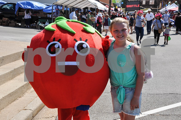 Wearing a tomato suit, Michaela Whitley, 9 and Emily Westerman, 10 (right) stopped for a photo at the 34th Annual Tomato Fest in Jacksonville on Saturday, June 9. (Jessica T. Payne/Tyler Paper)
