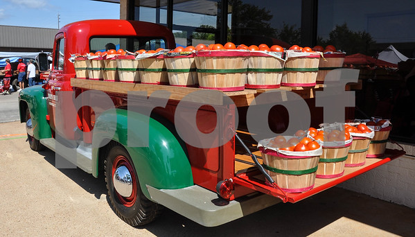 A Tomato Shed truck is filled with tomatoes for purchase at the 34th Annual Tomato Fest in Jacksonville on Saturday, June 9. Jacksonville is known for some of the best tomatoes in the state and currently hold the Guinness World record for Largest Bowl of Salsa. (Jessica T. Payne/Tyler Paper)