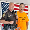 John P. Cleary | The Herald Bulletin <br /> Madison County Sheriff's Department Capt. Brian Bell speaks at the Walk for Hope Addiction Awareness event telling of when he arrested Bill Arnold, right, for drugs and now being a recovering addict they have become friends.