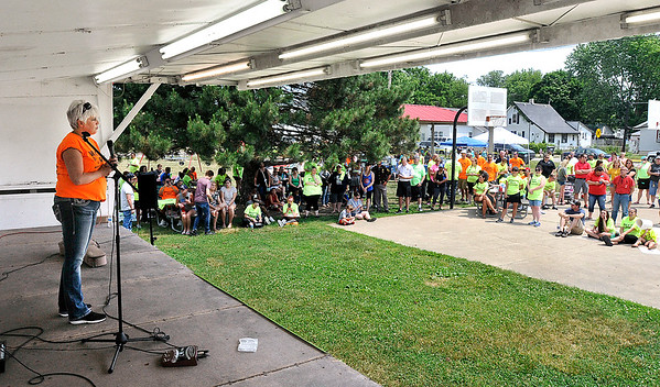John P. Cleary   The Herald Bulletin <br /> Mary Randol tells her story about loosing her son to addiction to the large crowd gathered for the Walk for Hope.