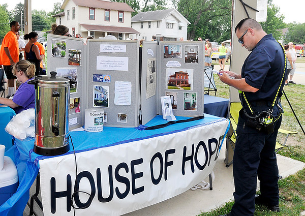 John P. Cleary | The Herald Bulletin <br /> Walk for Hope Addiction Awareness event and walk at Walnut Street Park in Anderson. Treatment and service providers were on hand to provide information and support for the event.