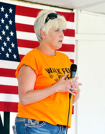 John P. Cleary | The Herald Bulletin <br /> Mary Randol tells her story about loosing her son to addiction to the large crowd gathered for the Walk for Hope.