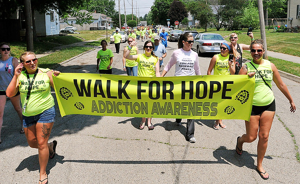 John P. Cleary | The Herald Bulletin <br /> Walk for Hope Addiction Awareness walk started from Walnut Street Park then south down Walnut Street to 23rd Street and back through the neighborhoods Saturday to raise addiction awareness in the community.