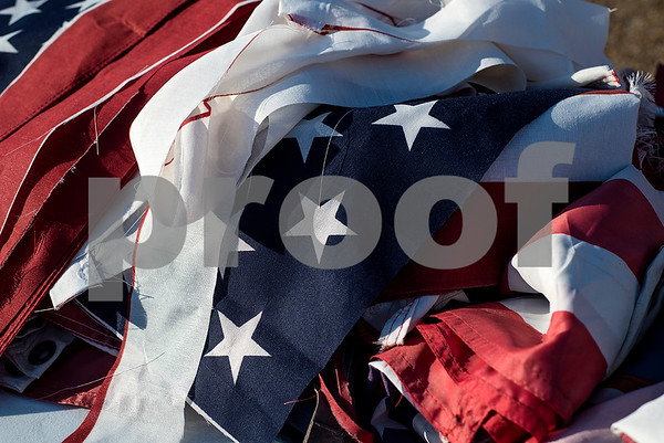 An American flag cut into pieces rests on a table during a flag retirement ceremony at Cozad Insurance Group in Lindale, Texas, on Tuesday, July 11, 2017. Scouts and members of the community retired 90 flags in the ceremony. (Chelsea Purgahn/Tyler Morning Telegraph)