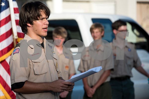 Joe Adams, 16, explains the significance of the ceremony during a flag retirement ceremony at Cozad Insurance Group in Lindale, Texas, on Tuesday, July 11, 2017. Scouts and members of the community retired 90 flags in the ceremony. (Chelsea Purgahn/Tyler Morning Telegraph)