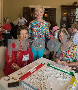 Shirley Hughes, Polly Richardson and Julia Coody play a game of Mah Jongg during the 16th annual Mah Jongg for Memory Luncheon and Games Day at Willow Brook Country Club in Tyler Thursday July 13, 2017. The event is a fundraiser for the Alzheimer's Alliance of Smith County. Over 400 people participated in the day-long event.  (Sarah A. Miller/Tyler Morning Telegraph)