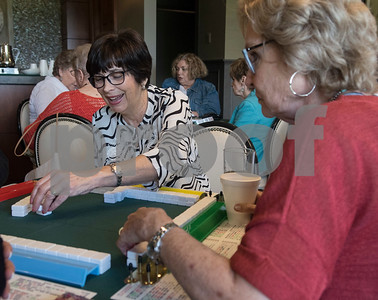 Sandra Greenberg takes her turn during a game of Mah Jongg during the 16th annual Mah Jongg for Memory Luncheon and Games Day at Willow Brook Country Club in Tyler Thursday July 13, 2017. The event is a fundraiser for the Alzheimer's Alliance of Smith County. Over 400 people participated in the day-long event.  (Sarah A. Miller/Tyler Morning Telegraph)