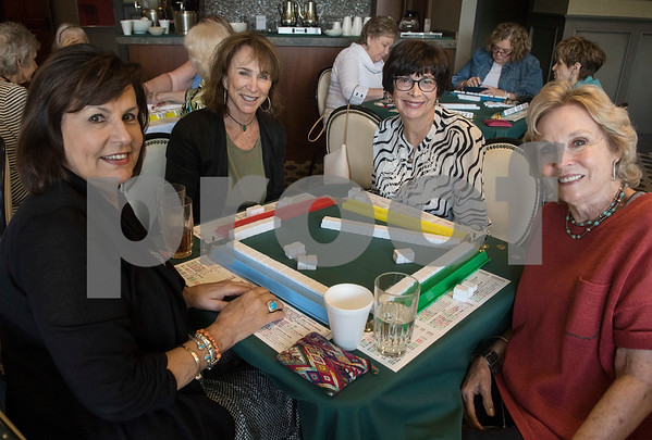 Linda Toney, Karma Crisp, Sandra Greenberg and Donna Culver play a game of Mah Jongg during the 16th annual Mah Jongg for Memory Luncheon and Games Day at Willow Brook Country Club in Tyler Thursday July 13, 2017. The event is a fundraiser for the Alzheimer's Alliance of Smith County. Over 400 people participated in the day-long event.  (Sarah A. Miller/Tyler Morning Telegraph)