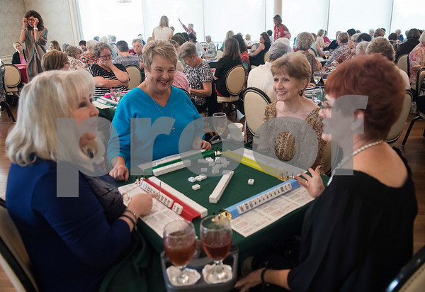 Marilyn Shipman, Lisa Mitchell, Donna Hutcheson and Judy Seifert play a game of Mah Jongg during the 16th annual Mah Jongg for Memory Luncheon and Games Day at Willow Brook Country Club in Tyler Thursday July 13, 2017. The event is a fundraiser for the Alzheimer's Alliance of Smith County. Over 400 people participated in the day-long event.  (Sarah A. Miller/Tyler Morning Telegraph)
