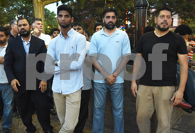 East Texas Islamic Society members Dr. Muzakeer Shaik, Asif Muneem, Yusuf Batliwila and Basilio Aguirre attend the community vigil to encourage unity among citizens in East Texas hosted by the City of Tyler Thursday, July 14 at T.B. Butler Fountain Square in downtown Tyler.  (Sarah A. Miller/Tyler Morning Telegraph)