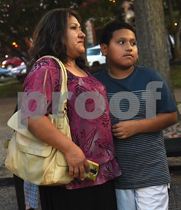 Rubith Aguirre of Tyler and Angel Aguirre, 12, attend the community vigil to encourage unity among citizens in East Texas hosted by the City of Tyler Thursday, July 14 at T.B. Butler Fountain Square in downtown Tyler.  (Sarah A. Miller/Tyler Morning Telegraph)