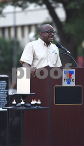 Darryl Bowdre, city councilman and pastor of Church of Christ at South Central speaks at the community vigil to encourage unity among citizens in East Texas hosted by the City of Tyler Thursday, July 14 at T.B. Butler Fountain Square in downtown Tyler.  (Sarah A. Miller/Tyler Morning Telegraph)
