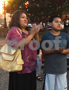 Rubith Aguirre of Tyler and Angel Aguirre, 12, applaud during the community vigil to encourage unity among citizens in East Texas hosted by the City of Tyler Thursday, July 14 at T.B. Butler Fountain Square in downtown Tyler.  (Sarah A. Miller/Tyler Morning Telegraph)
