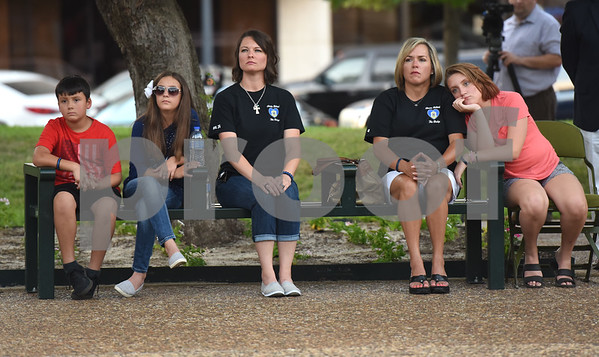 Ethan Yates, 8, Eva Yates, 11, Joelene Yates, Tanya Toler and Gracie Casey attend the community vigil to encourage unity among citizens in East Texas hosted by the City of Tyler Thursday, July 14 at T.B. Butler Fountain Square in downtown Tyler.  (Sarah A. Miller/Tyler Morning Telegraph)