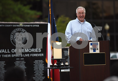 Tyler Mayor Martin Heines speaks during the community vigil to encourage unity among citizens in East Texas hosted by the City of Tyler Thursday, July 14 at T.B. Butler Fountain Square in downtown Tyler.  (Sarah A. Miller/Tyler Morning Telegraph)