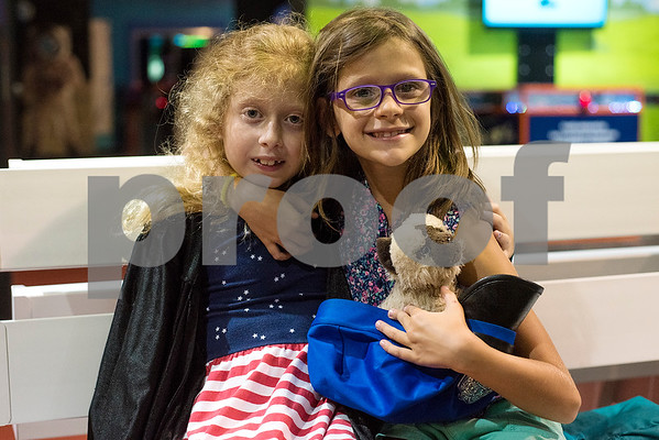 Abigail Dixon, 8,  and Arianna Sfondrini, 7, pose for a photo during a Family Fun Day event hosted by the Tyler Morning Telegraph at Discovery Science Place in Tyler, Texas, on Tuesday, July 18, 2017. Kids received balloons and goody bags and had a chance to win prizes. (Chelsea Purgahn/Tyler Morning Telegraph)