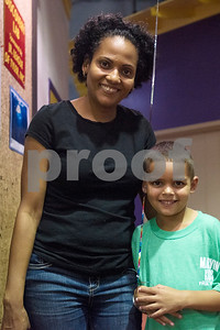 Rica and Will McKenzie, 6, pose for a photo during a Family Fun Day event hosted by the Tyler Morning Telegraph at Discovery Science Place in Tyler, Texas, on Tuesday, July 18, 2017. Kids received balloons and goody bags and had a chance to win prizes. (Chelsea Purgahn/Tyler Morning Telegraph)