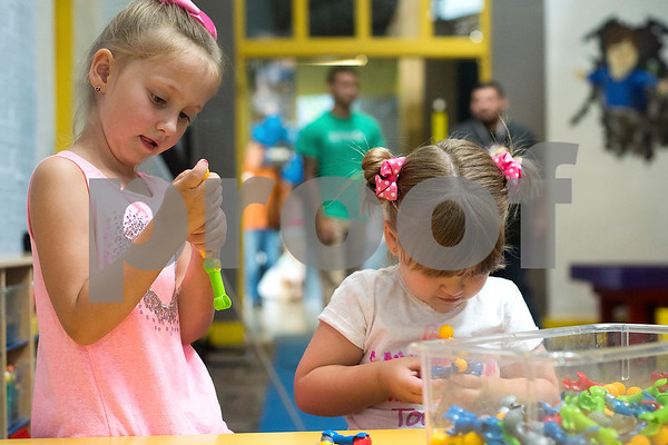 Bridgett Harmon, 6, and Tinley, 4, build things during a Family Fun Day event hosted by the Tyler Morning Telegraph at Discovery Science Place in Tyler, Texas, on Tuesday, July 18, 2017. Kids received balloons and goody bags and had a chance to win prizes. (Chelsea Purgahn/Tyler Morning Telegraph)