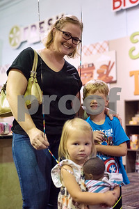 Reba, Emma, 2, and MJ Daly, 4, pose for a photo during a Family Fun Day event hosted by the Tyler Morning Telegraph at Discovery Science Place in Tyler, Texas, on Tuesday, July 18, 2017. Kids received balloons and goody bags and had a chance to win prizes. (Chelsea Purgahn/Tyler Morning Telegraph)