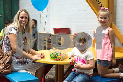 Brittany, Tinley, 4, and Bridgett Harmon, 6, pose for a photo during a Family Fun Day event hosted by the Tyler Morning Telegraph at Discovery Science Place in Tyler, Texas, on Tuesday, July 18, 2017. Kids received balloons and goody bags and had a chance to win prizes. (Chelsea Purgahn/Tyler Morning Telegraph)