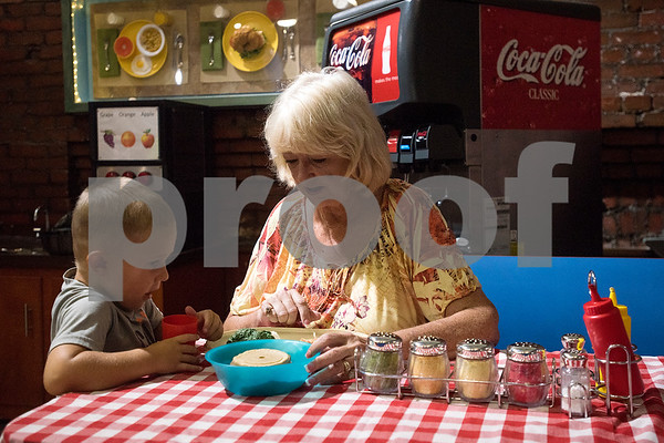 Brysen Hart, 3, serves Robbye Rowe a meal during a Family Fun Day event hosted by the Tyler Morning Telegraph at Discovery Science Place in Tyler, Texas, on Tuesday, July 18, 2017. Kids received balloons and goody bags and had a chance to win prizes. (Chelsea Purgahn/Tyler Morning Telegraph)