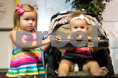 Ryann, 2, and Pacey Paine, 11 months, pose for a photo during a Family Fun Day event hosted by the Tyler Morning Telegraph at Discovery Science Place in Tyler, Texas, on Tuesday, July 18, 2017. Kids received balloons and goody bags and had a chance to win prizes. (Chelsea Purgahn/Tyler Morning Telegraph)