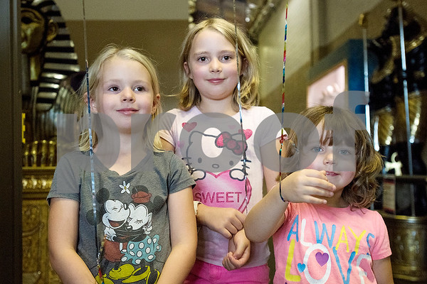 Ivy, 6, Lucy, 7, and Ruth Kelling, 4, pose for a photo during a Family Fun Day event hosted by the Tyler Morning Telegraph at Discovery Science Place in Tyler, Texas, on Tuesday, July 18, 2017. Kids received balloons and goody bags and had a chance to win prizes. (Chelsea Purgahn/Tyler Morning Telegraph)