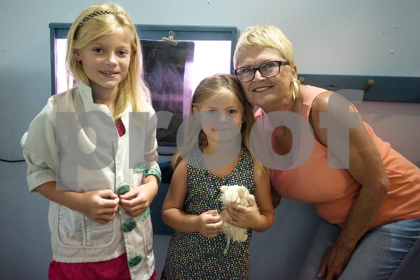 Katie Faye Putman, 7, Avery Putman, 5, and Sandi Guerin pose for a photo during a Family Fun Day event hosted by the Tyler Morning Telegraph at Discovery Science Place in Tyler, Texas, on Tuesday, July 18, 2017. Kids received balloons and goody bags and had a chance to win prizes. (Chelsea Purgahn/Tyler Morning Telegraph)