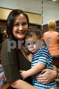 Sharon and Sawyer Garner, 3, pose for a photoduring a Family Fun Day event hosted by the Tyler Morning Telegraph at Discovery Science Place in Tyler, Texas, on Tuesday, July 18, 2017. Kids received balloons and goody bags and had a chance to win prizes. (Chelsea Purgahn/Tyler Morning Telegraph)