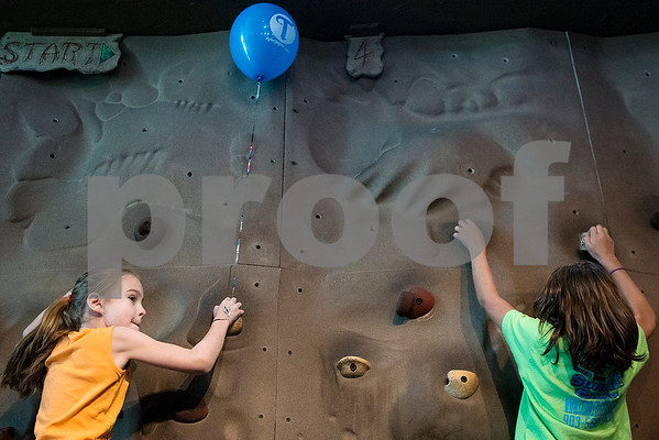 Peyten Jordan, 7, and Jessica Warren, 10, climb a rock wall during a Family Fun Day event hosted by the Tyler Morning Telegraph at Discovery Science Place in Tyler, Texas, on Tuesday, July 18, 2017. Kids received balloons and goody bags and had a chance to win prizes. (Chelsea Purgahn/Tyler Morning Telegraph)