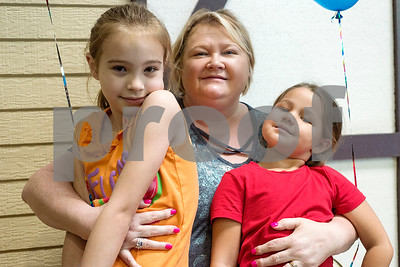 Peyten Jordan, 7, Vicki Jordan, and Emma Parker, 5, pose for a photo during a Family Fun Day event hosted by the Tyler Morning Telegraph at Discovery Science Place in Tyler, Texas, on Tuesday, July 18, 2017. Kids received balloons and goody bags and had a chance to win prizes. (Chelsea Purgahn/Tyler Morning Telegraph)