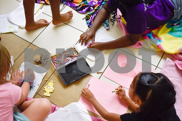 Girls color during Rose City Summer Camps at Dixie Elementary School in Tyler, Texas, on Wednesday, July 19, 2017. Rose City Summer Camps, a ministry of The Mentoring Alliance, is a faith-based and academic summer camp for kids. (Chelsea Purgahn/Tyler Morning Telegraph)