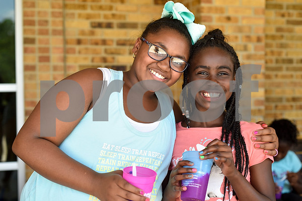 Zariya Green, 10, and Sanaa Jackson, 10, pose for a photo during Rose City Summer Camps at Dixie Elementary School in Tyler, Texas, on Wednesday, July 19, 2017. Rose City Summer Camps, a ministry of The Mentoring Alliance, is a faith-based and academic summer camp for kids. (Chelsea Purgahn/Tyler Morning Telegraph)