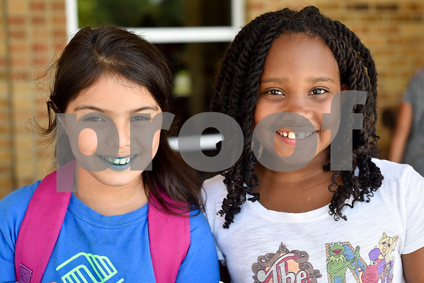 Elyanie Arriaga, 9, and Leela Holman, 8, pose for a photo during Rose City Summer Camps at Dixie Elementary School in Tyler, Texas, on Wednesday, July 19, 2017. Rose City Summer Camps, a ministry of The Mentoring Alliance, is a faith-based and academic summer camp for kids. (Chelsea Purgahn/Tyler Morning Telegraph)