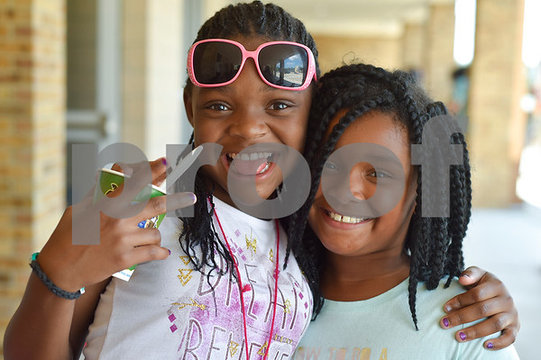 Violet Jones, 9, and Sydney Walker, 9, pose for a photo during Rose City Summer Camps at Dixie Elementary School in Tyler, Texas, on Wednesday, July 19, 2017. Rose City Summer Camps, a ministry of The Mentoring Alliance, is a faith-based and academic summer camp for kids. (Chelsea Purgahn/Tyler Morning Telegraph)