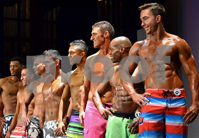 Contestants line up in the men's physique category during the pre-judging round of the PureBody Nutrition Extravaganza Bodybuilding Show on Saturday morning at the Caldwell Auditorium. (Victor Texcucano)