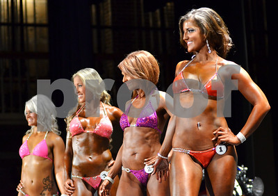 Women compete in the bikini category of Saturday's bodybuilding show. (Victor Texcucano)