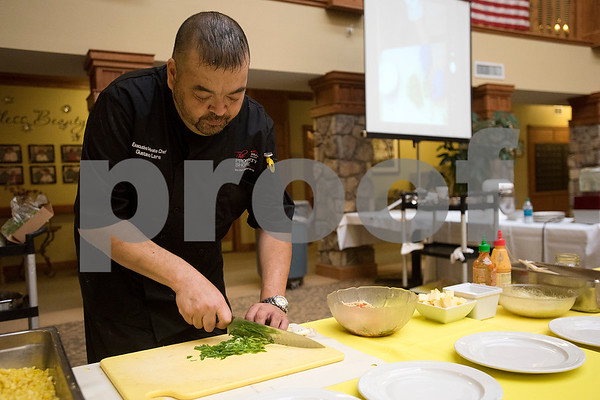 Gustavo Lara chops green onions during the chef showdown at Atria Willow Park in Tyler, Texas, on Thursday, July 20, 2017. Two teams faced off and cooked an appetizer, entree and dessert for judges, with all dishes including corn. (Chelsea Purgahn/Tyler Morning Telegraph)